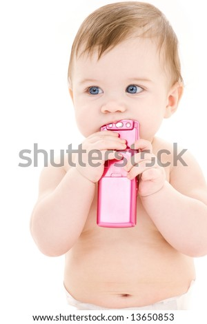 picture of baby boy in diaper with pink cell phone - stock photo