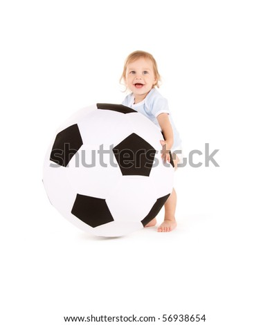 picture of baby boy with soccer ball over white - stock photo