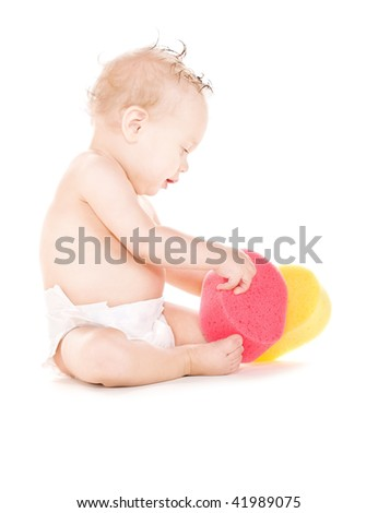 picture of baby boy with sponges over white