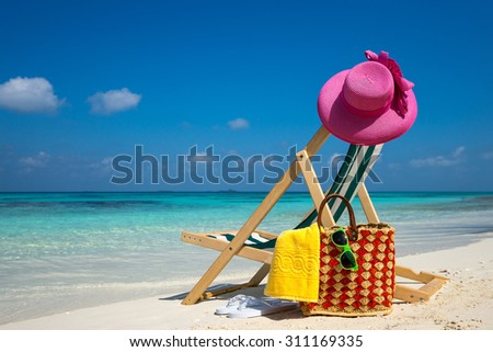 Picture of Beach lounger on the tropical beach, vacation. Traveler dreams concept - stock photo