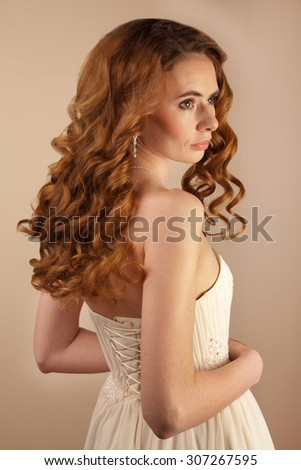 Picture of beautiful bride wedding dress and curly hairstyle - stock photo