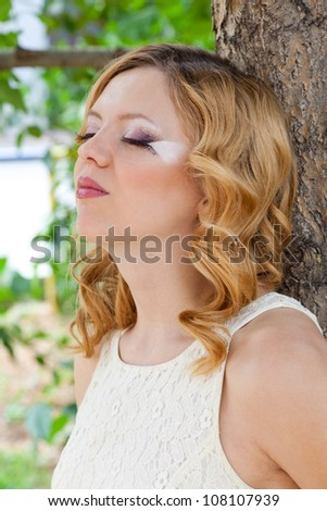 Picture of beautiful bride with creative make up outdoors - stock photo