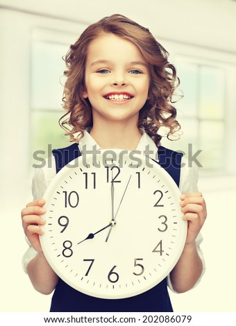 picture of beautiful girl with big clock - stock photo