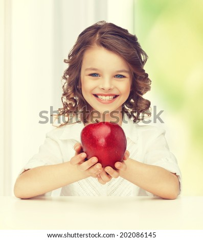 picture of beautiful girl with red apple - stock photo