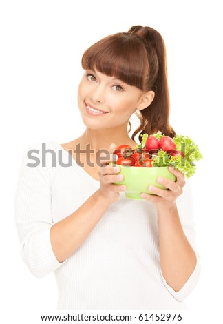 picture of beautiful housewife with vegetables over white - stock photo