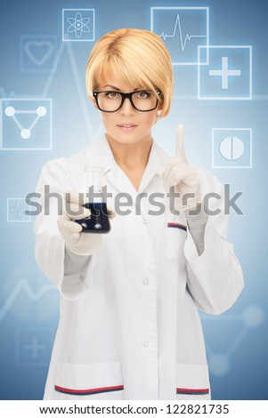 picture of beautiful lab worker holding up test tube. - stock photo