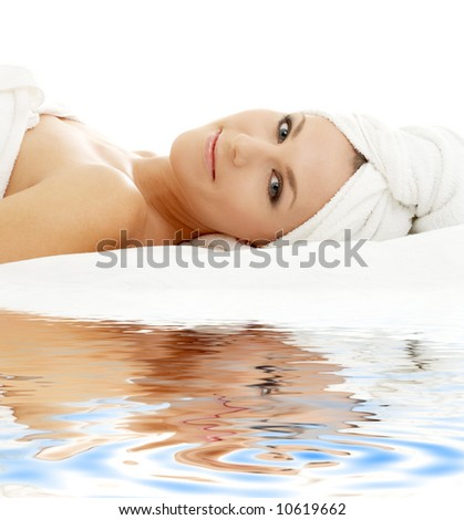 picture of beautiful lady relaxing on white sand - stock photo