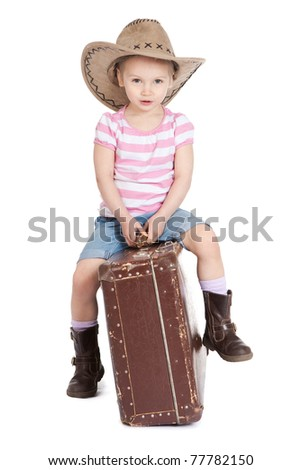 Picture of beautiful little girl in a cowboy hat with a suitcase over white - stock photo