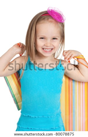 Picture of beautiful little girl with shopping bags on white background - stock photo