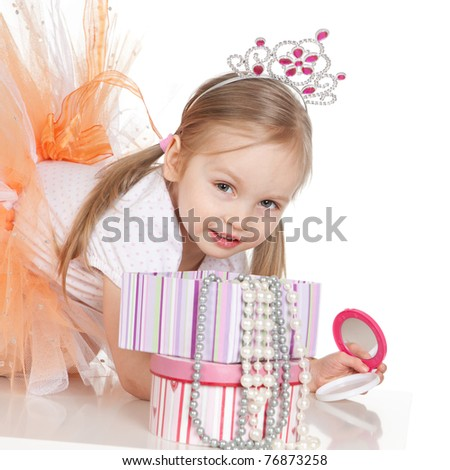Picture of beautiful little princess girl with a mirror over white - stock photo