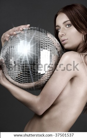 picture of beautiful naked woman with disco ball - stock photo