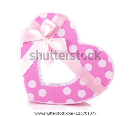 Picture of beautiful pink heart-shaped gift-box isolated on white background, romantic present with decorative ribbon bow, Valentine day, luxury symbolic container for holiday sweets, love concept - stock photo