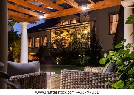 Picture of beautiful residence with garden at night - stock photo