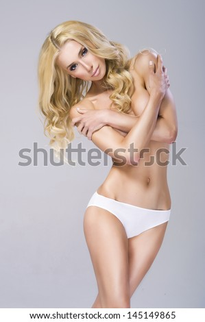 Picture of beautiful topless woman in panties - stock photo