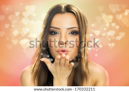 Picture of beautiful woman blowing hearts, cute female send romantic kiss, Cupid girl, Valentines day, sweet holiday, romance and love concept - stock photo