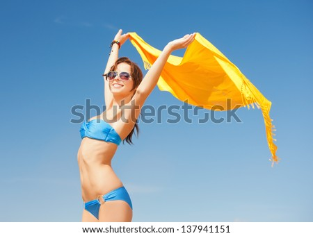 picture of beautiful woman in bikini and sunglasses - stock photo