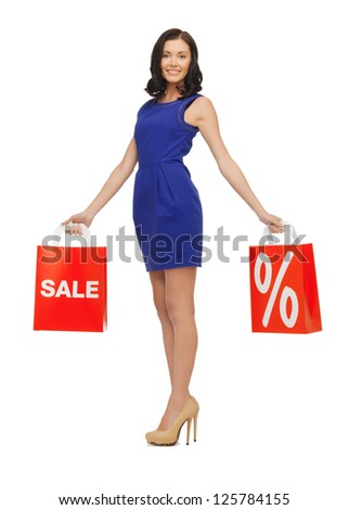 picture of beautiful woman in blue dress with shopping bag - stock photo