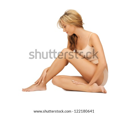 picture of beautiful woman in cotton undrewear touching her legs