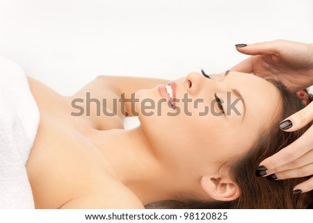 picture of beautiful woman in massage salon - stock photo