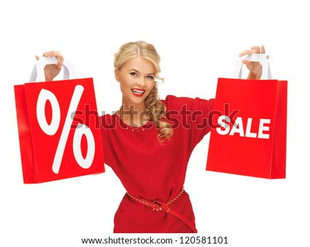 picture of beautiful woman in red dress with shopping bag - stock photo