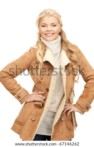 picture of beautiful woman in sheepskin jacket - stock photo