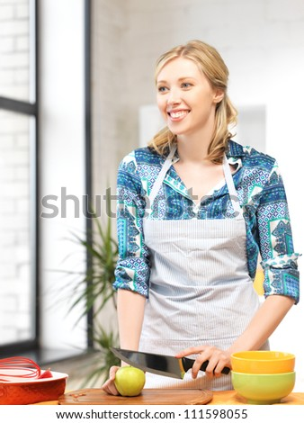 picture of beautiful woman in the kitchen.. - stock photo