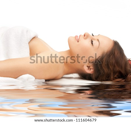 picture of beautiful woman on white sand - stock photo