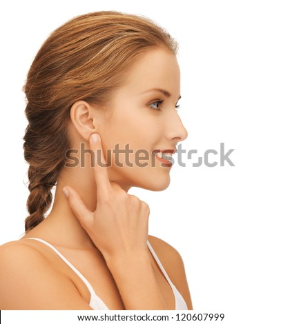 picture of beautiful woman pointing to ear - stock photo