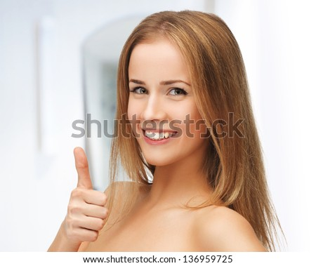 picture of beautiful woman showing thumbs up - stock photo