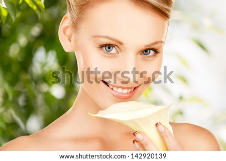 picture of beautiful woman with calla flower - stock photo