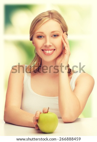 picture of beautiful woman with green apple. - stock photo