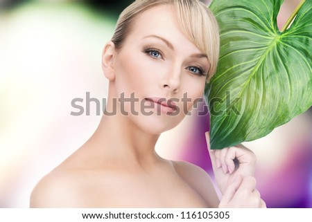 picture of beautiful woman with green leaf . - stock photo