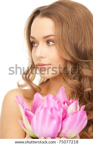 picture of beautiful woman with lotus flower - stock photo