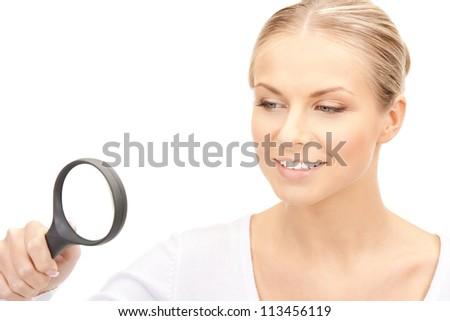picture of beautiful woman with magnifying glass... - stock photo