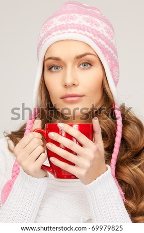 picture of beautiful woman with red mug - stock photo