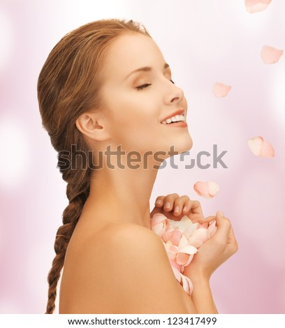 picture of beautiful woman with rose petals.. - stock photo