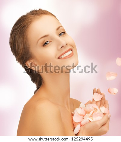 picture of beautiful woman with rose petals..