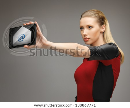 picture of beautiful woman with tablet pc and email icon - stock photo
