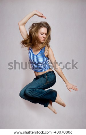 picture of beautiful young woman blond long hair jumping very up.