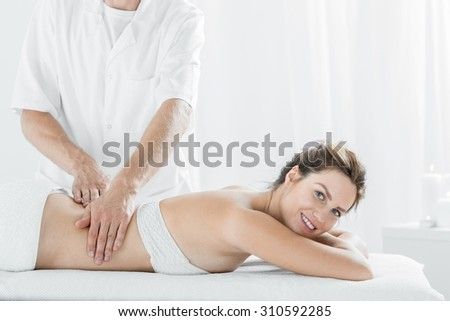 Picture of beautiful young woman during relaxing massage  - stock photo