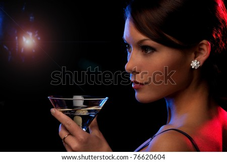 picture of beautiful young woman with a cocktail - stock photo