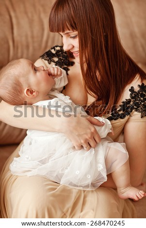 picture of beuty young mother with adorable baby