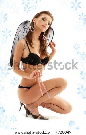 picture of black lingerie angel on high heels with snowflakes - stock photo