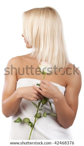 Picture of blonde holding a rose and staring around