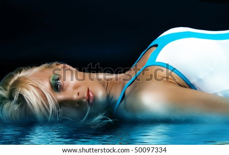 Picture of blonde near blue water