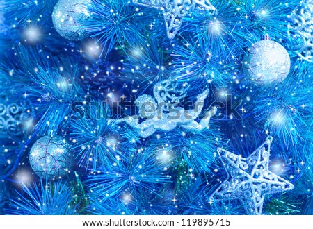 Picture of blue Christmas tree background, Christmastime fir decorations, star, bauble and angel decorated holiday spruce, happy New Year greeting card, xmas celebration, abstract wallpaper - stock photo