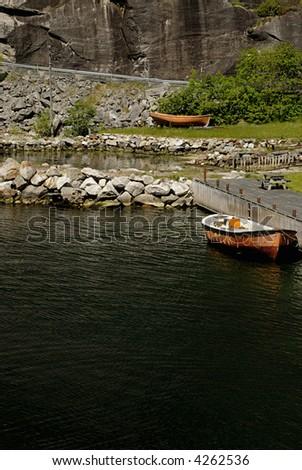 Picture of boat in dock in Lysefjord - fjord near Stavanger in Norway. - stock photo