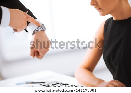 picture of boss and worker at work having conflict - stock photo