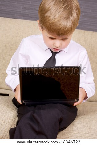 picture of  boy with black laptop computer