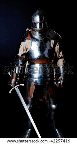Picture of brave knight holding a sword - stock photo